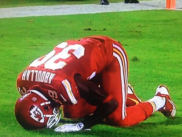 Husain Abdullah prostrates himself in the end zone in prayer to Allah after scoring a touchdown.