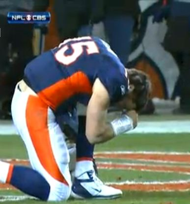 The famous, or infamous, Tim Tebow prayer position during a football game.